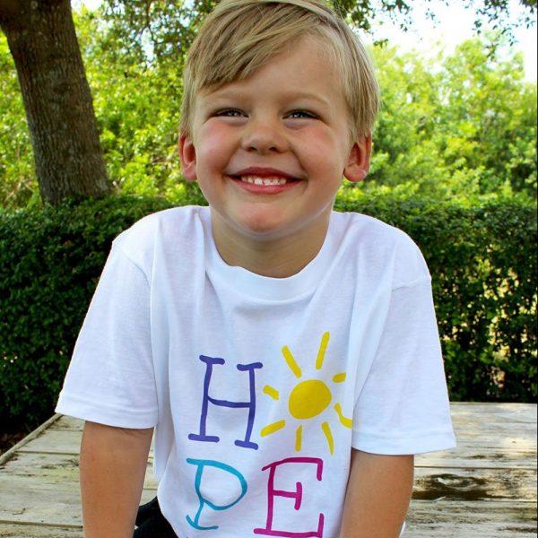 handsome boy wearing Hope Sunshine shirt