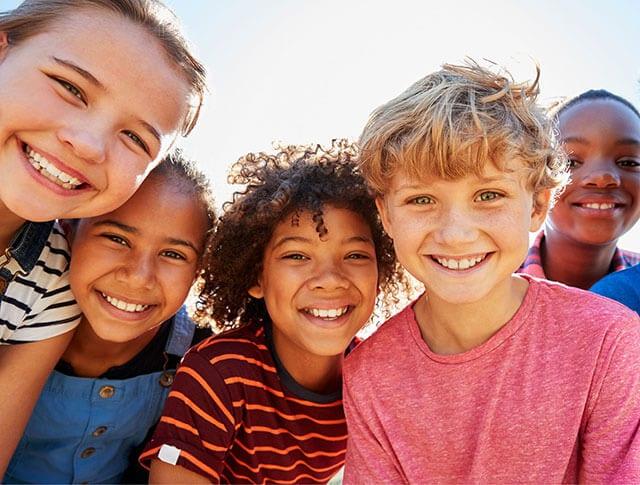 Group of diverse Kids' Minds Matter children smile at the camera